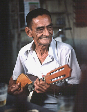 A Peruvian musician plays huayno music on his mandolin.